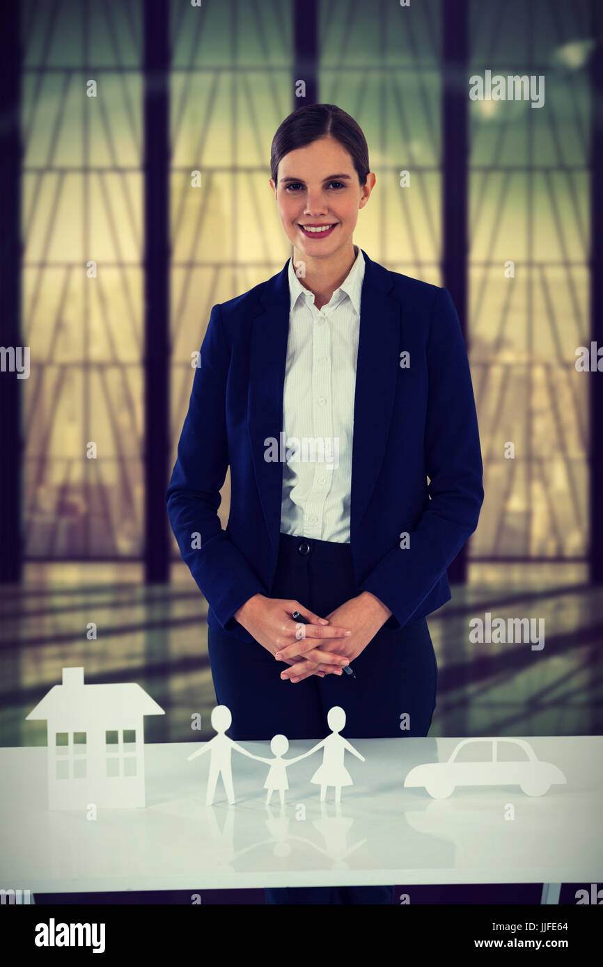 insurer with different property to insure against room with large window looking on city - Stock Image
