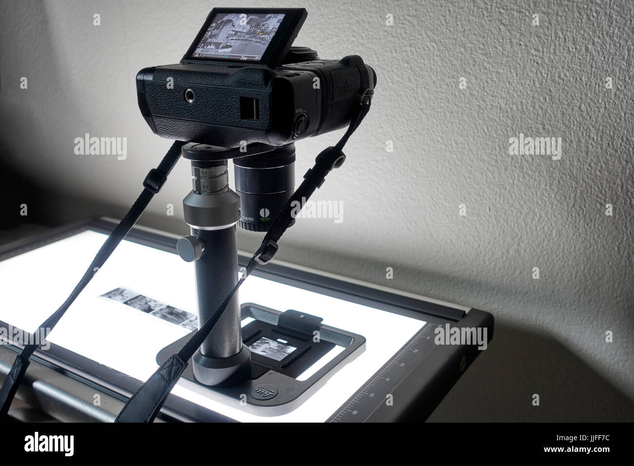 Film copying and digitizing rig. Leica Beoon and digital camera used to digitise photography film. Film scanner, - Stock Image