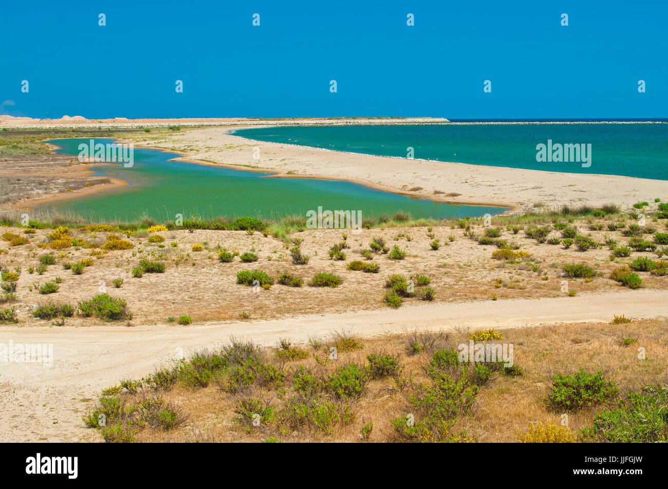 view of Llobregat river delta and Mediterranean sea beach on sunny summer day in El Prat, Barcelona, Catalonia, - Stock Image