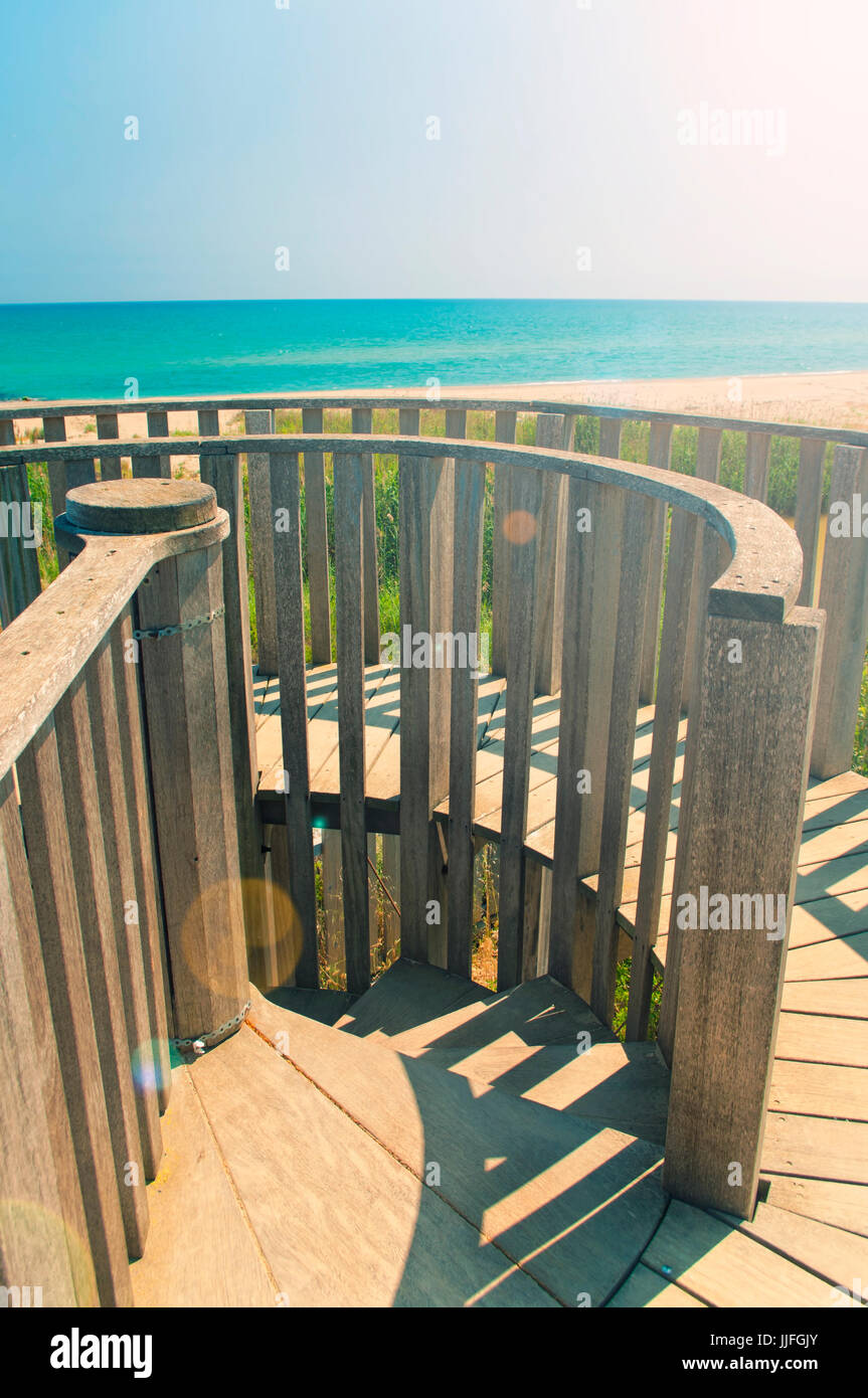 view of Mediterranean sea from wooden observation tower on sunny day in El Prat, barcelona, Catalonia, Spain - Stock Image