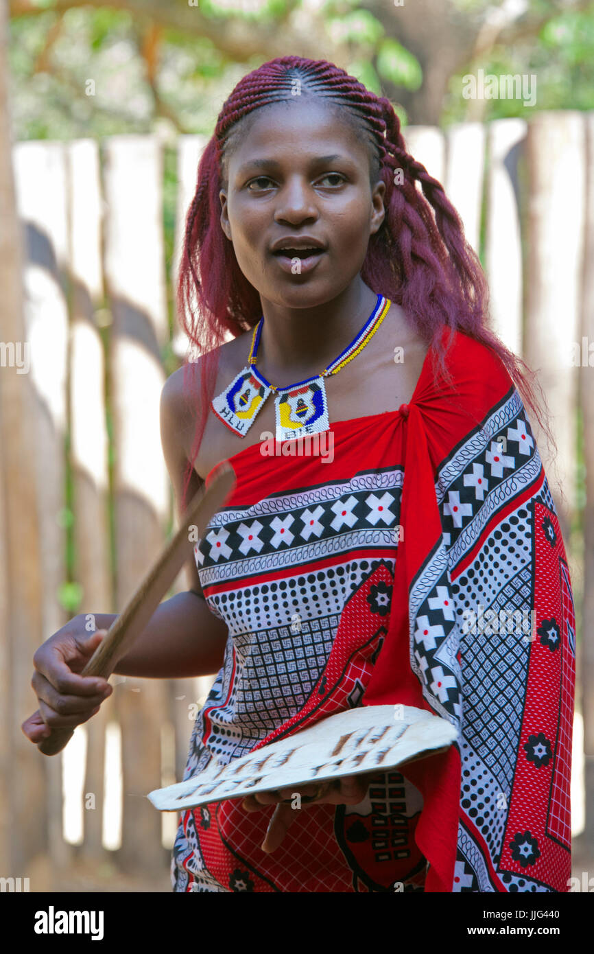 Pretty girl tribal singing Mantenga Cultural Village Swaziland Southern Africa - Stock Image