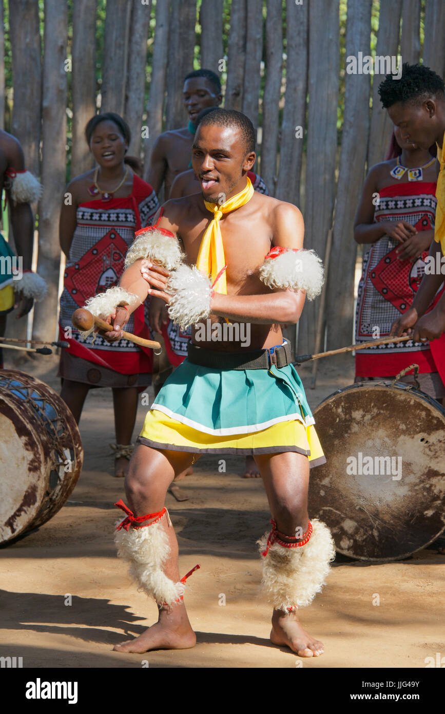 Tribal man performing traditional dance to the beat of drums Mantenga Cultural Village Swaziland Southern Africa - Stock Image