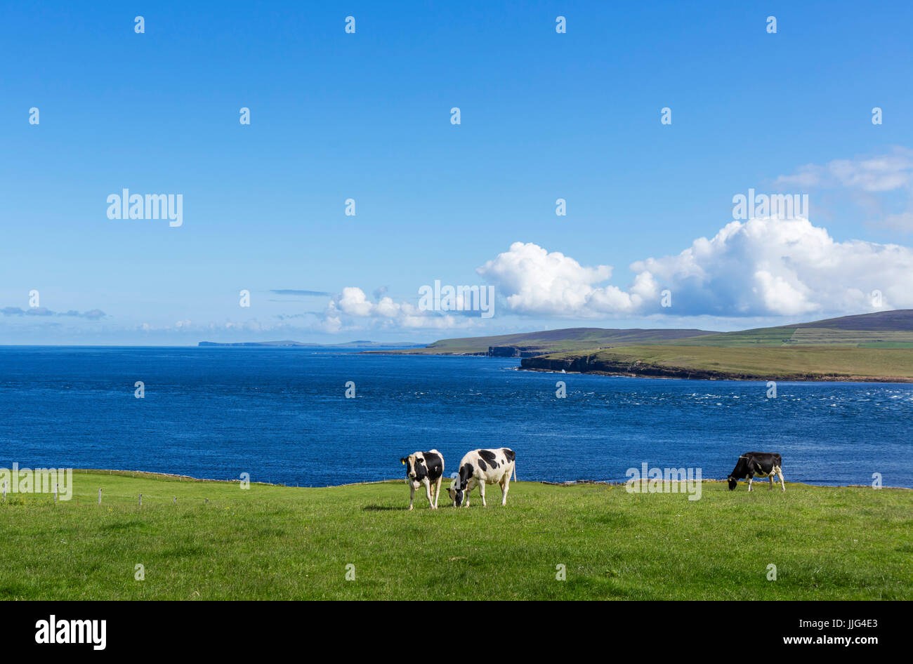 View from the A966 on the northern coast of Mainland looking towards Rousay with Westray in the distance, Orkney, - Stock Image