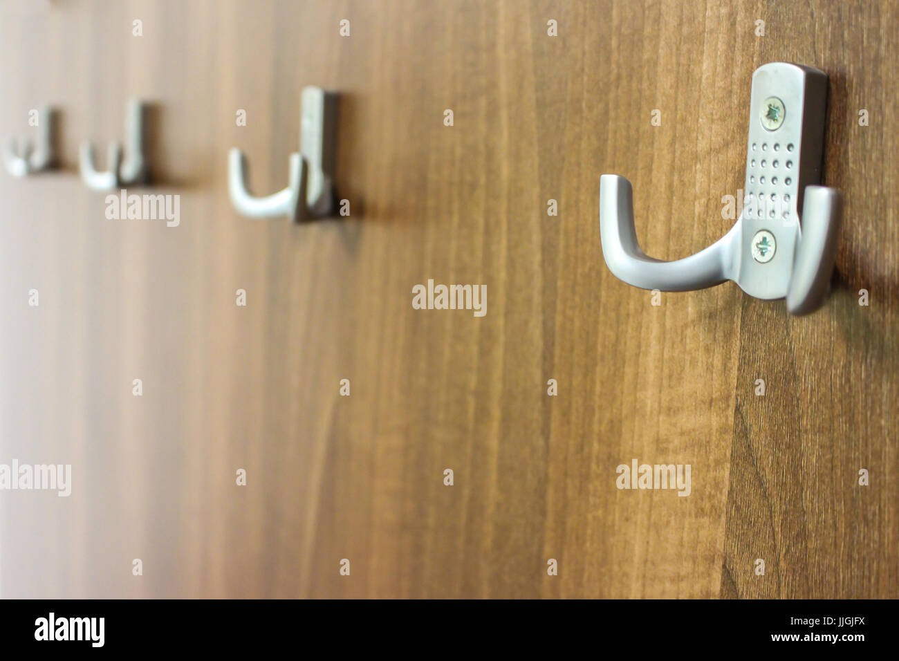 Close up to some hanger in straight line - Stock Image