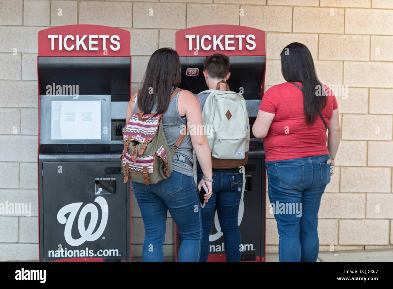 Washington, DC - Baseball fans buy tickets for a Washington Nationals game from an automated ticket machine at Nationals - Stock Image
