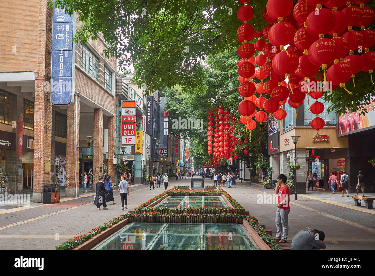 Guangzhou street life with people shopping in Beijing Lu main shopping street, Guangzhou, China - Stock Image