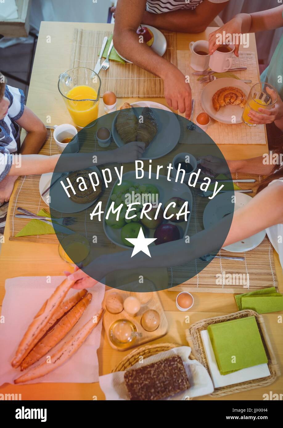 White fourth of July graphic in blue circle against overhead of family dinner with red overlay - Stock Image