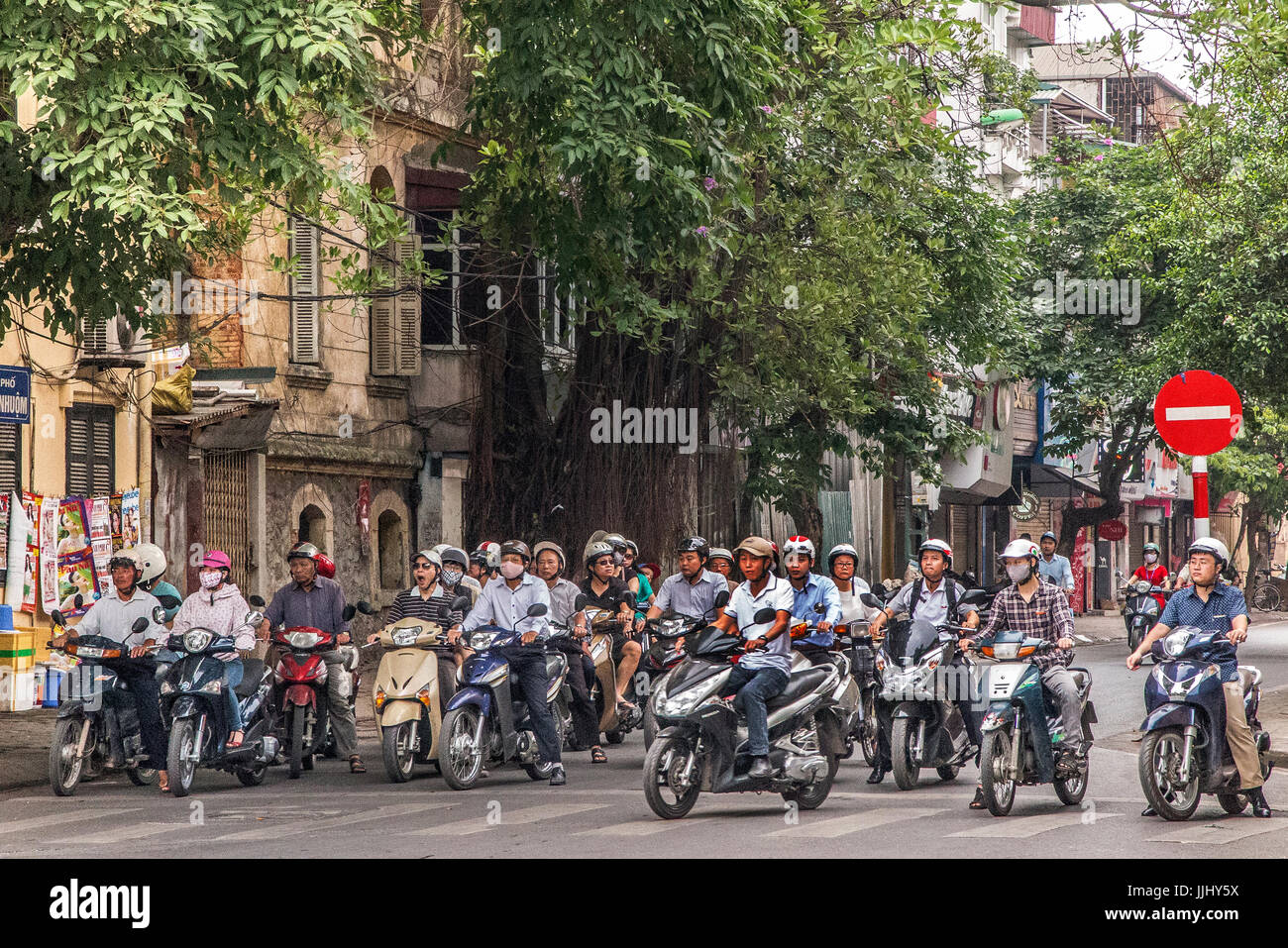 Early morning street scene with motorbikes Hanoi Vietnam - Stock Image