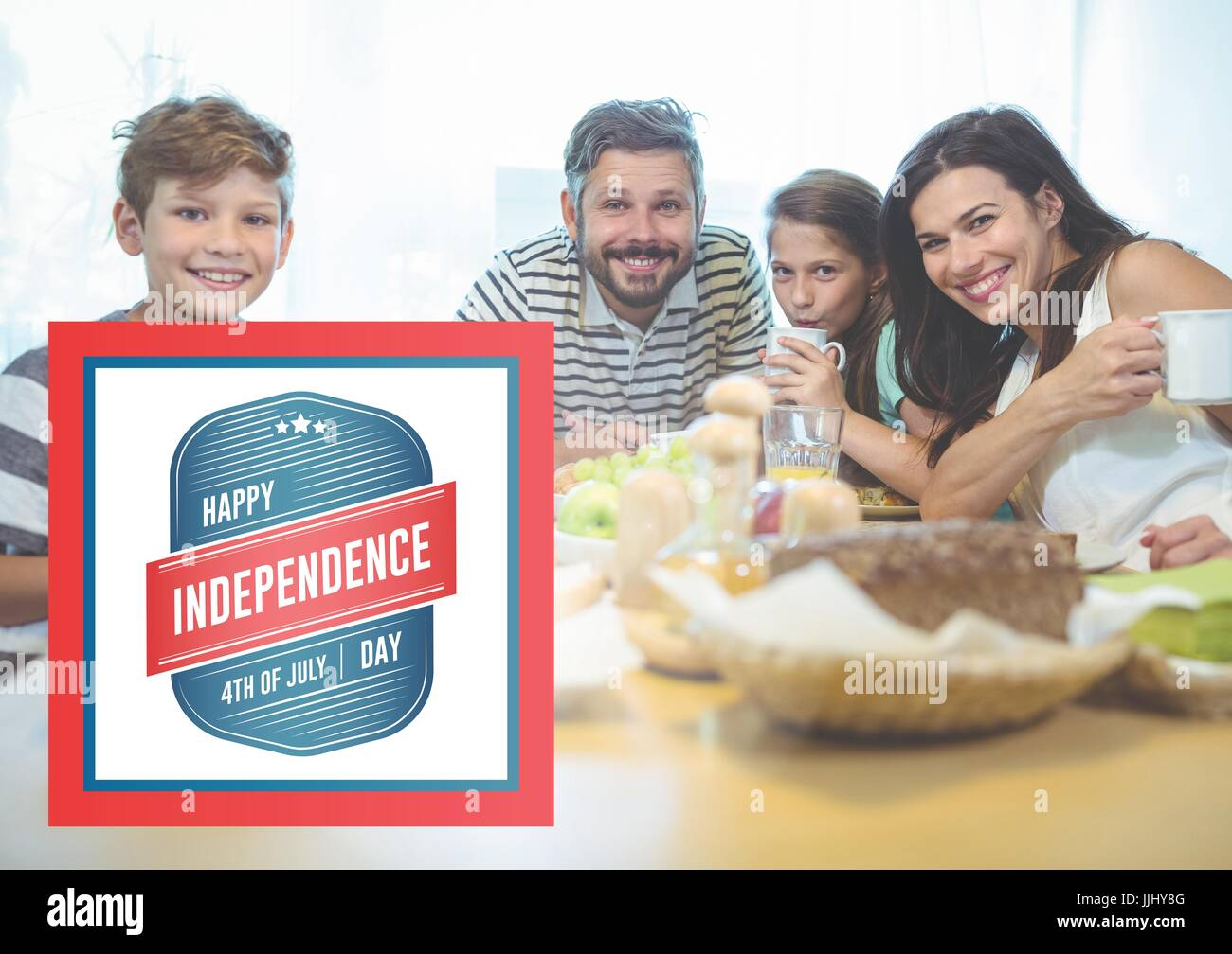 Smiling family having a breakfast for the independence day - Stock Image