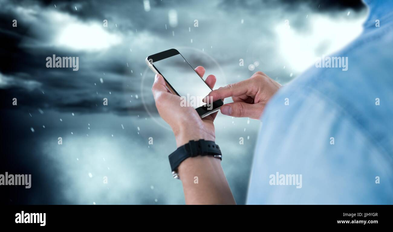 Part of a businessman texting in darkness - Stock Image