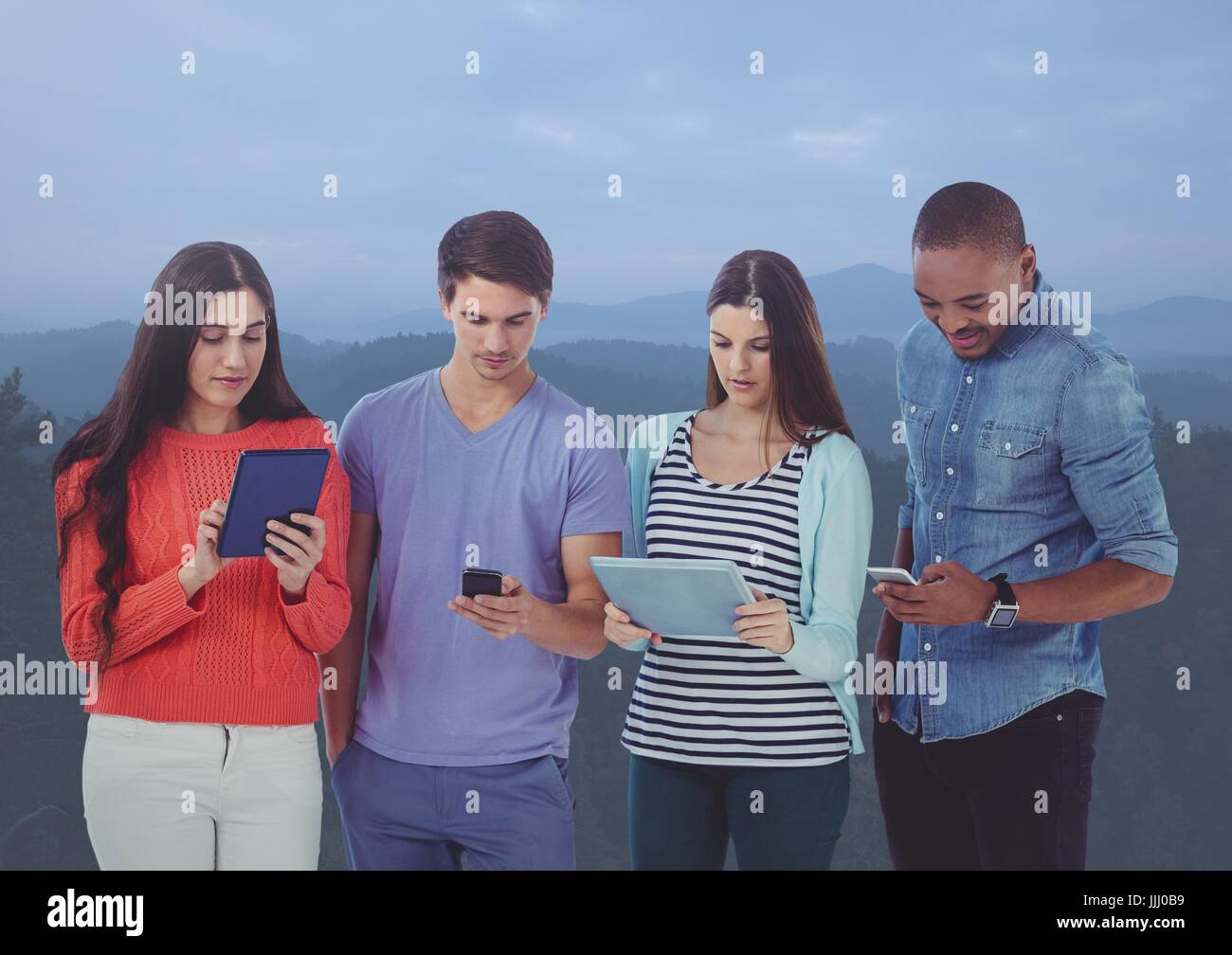 Friends using digital tablets and mobile phone in darkness atmosphere - Stock Image