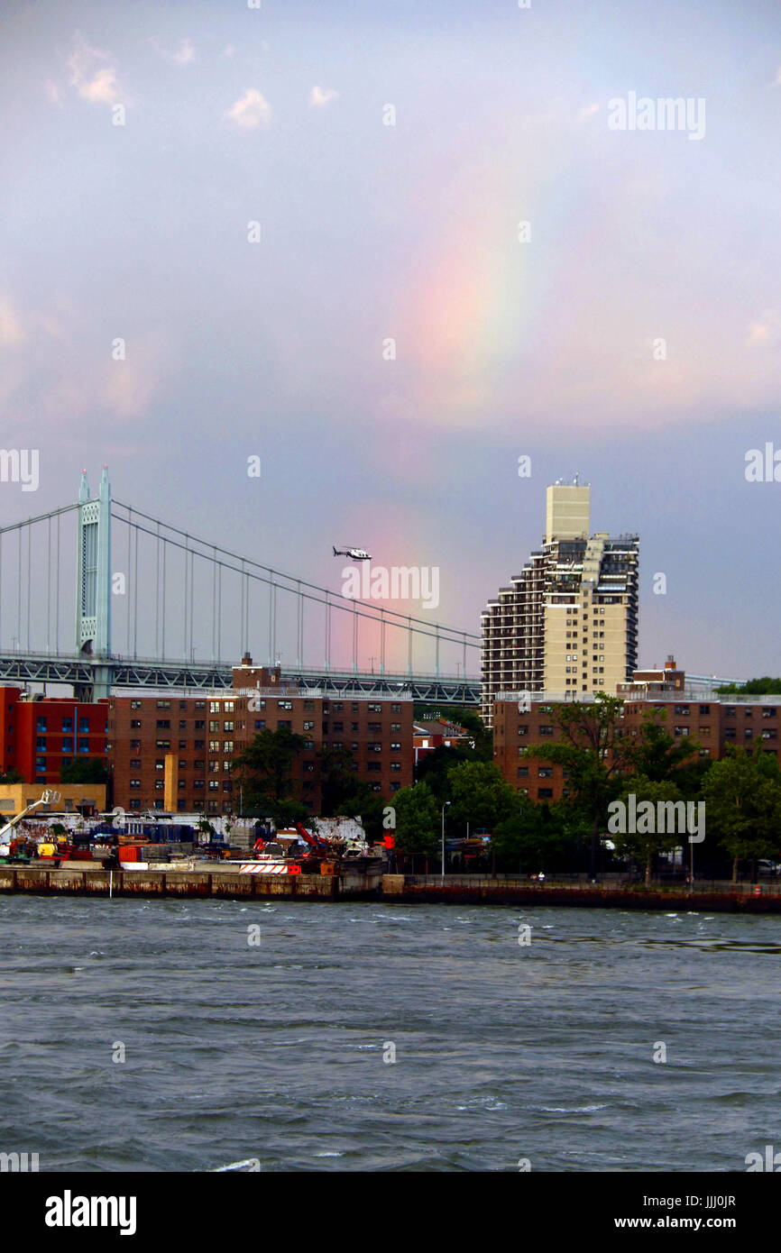 Rainbow over Triborough Bridge and East River - Stock Image
