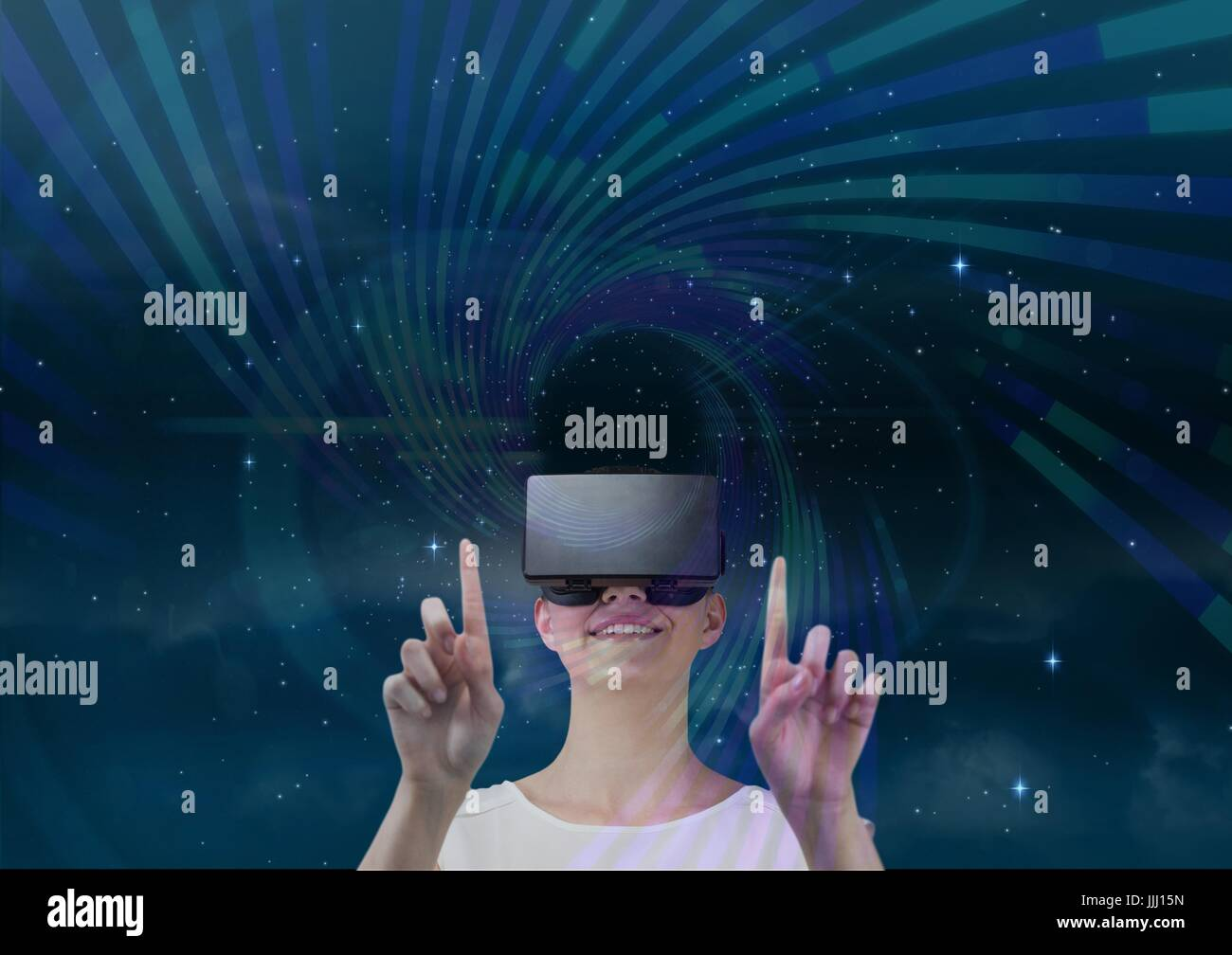 Woman in VR headset touching purple and green interface against blue sky with stars - Stock Image