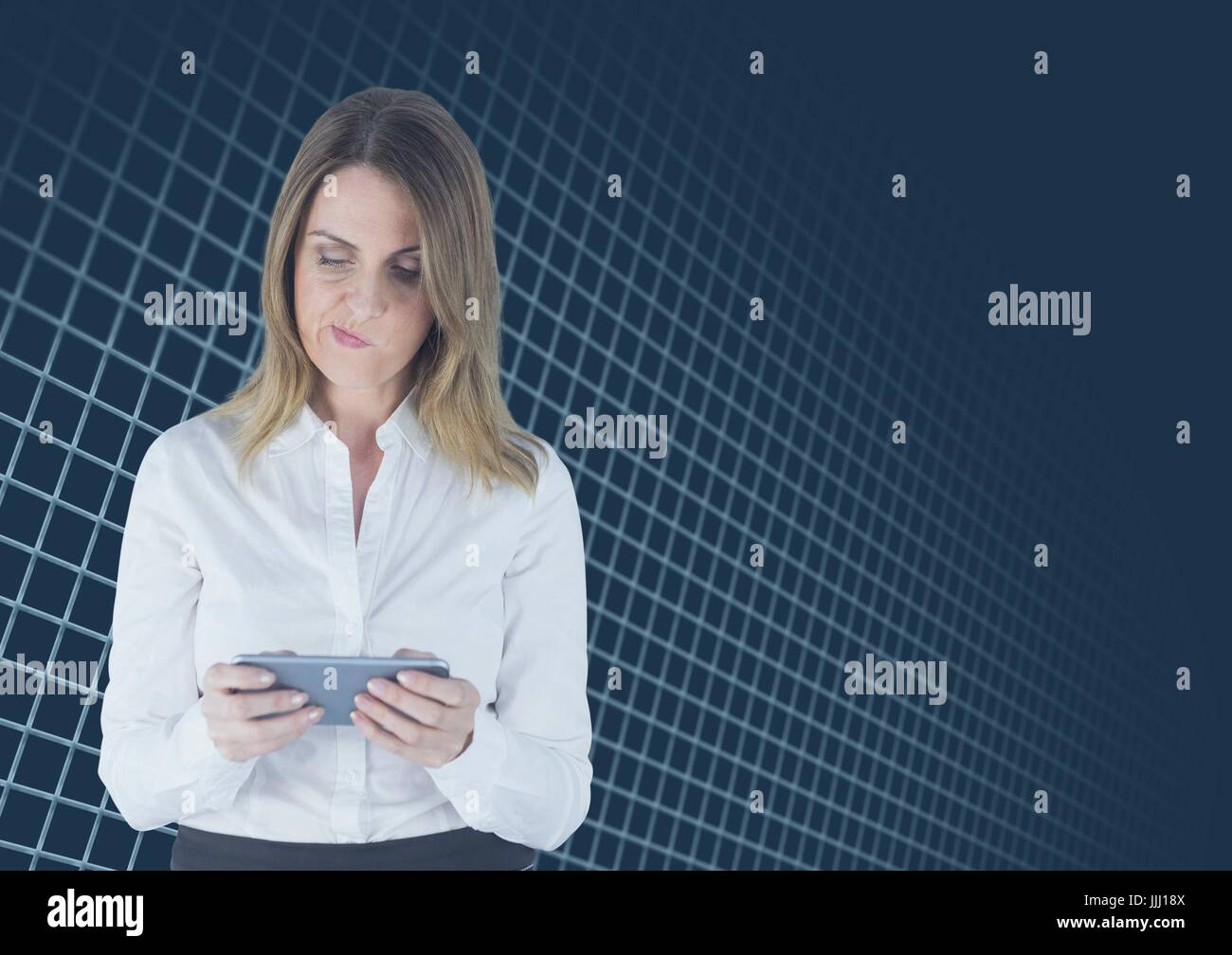 Dubious woman texting on blue interface - Stock Image