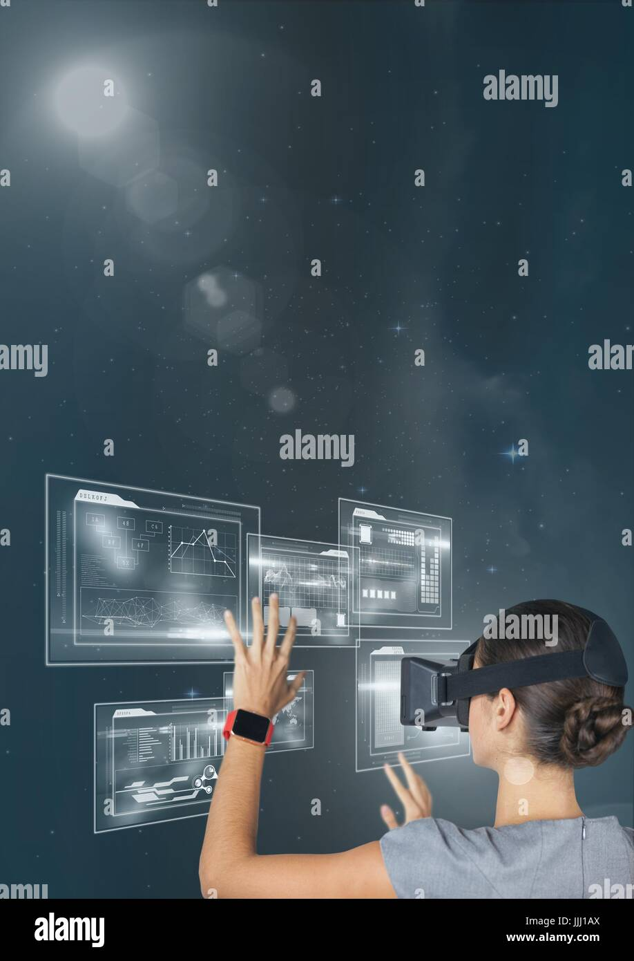 Woman in VR headset touching interface against blue sky with stars and flares - Stock Image