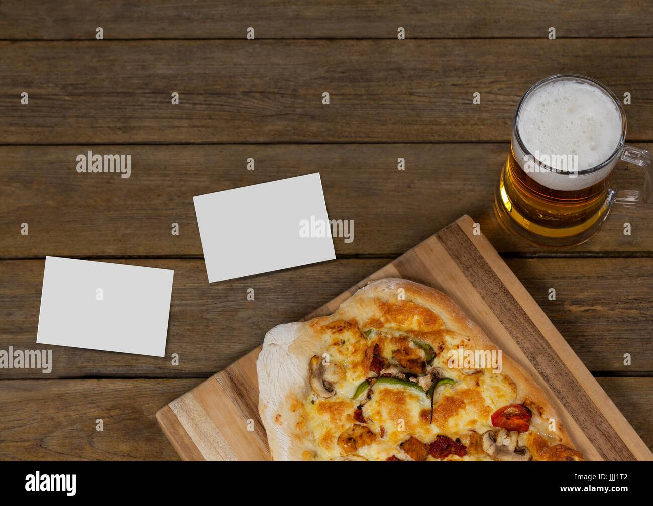 Bussiness cards on wooden desk with food and copy space - Stock Image