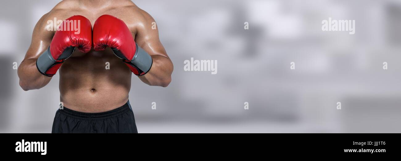 Boxer fighter man with blurred background and copy space - Stock Image