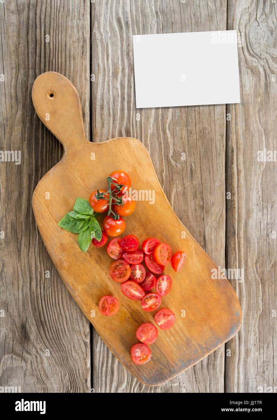 Bussiness card on wooden desk with food and copy space - Stock Image