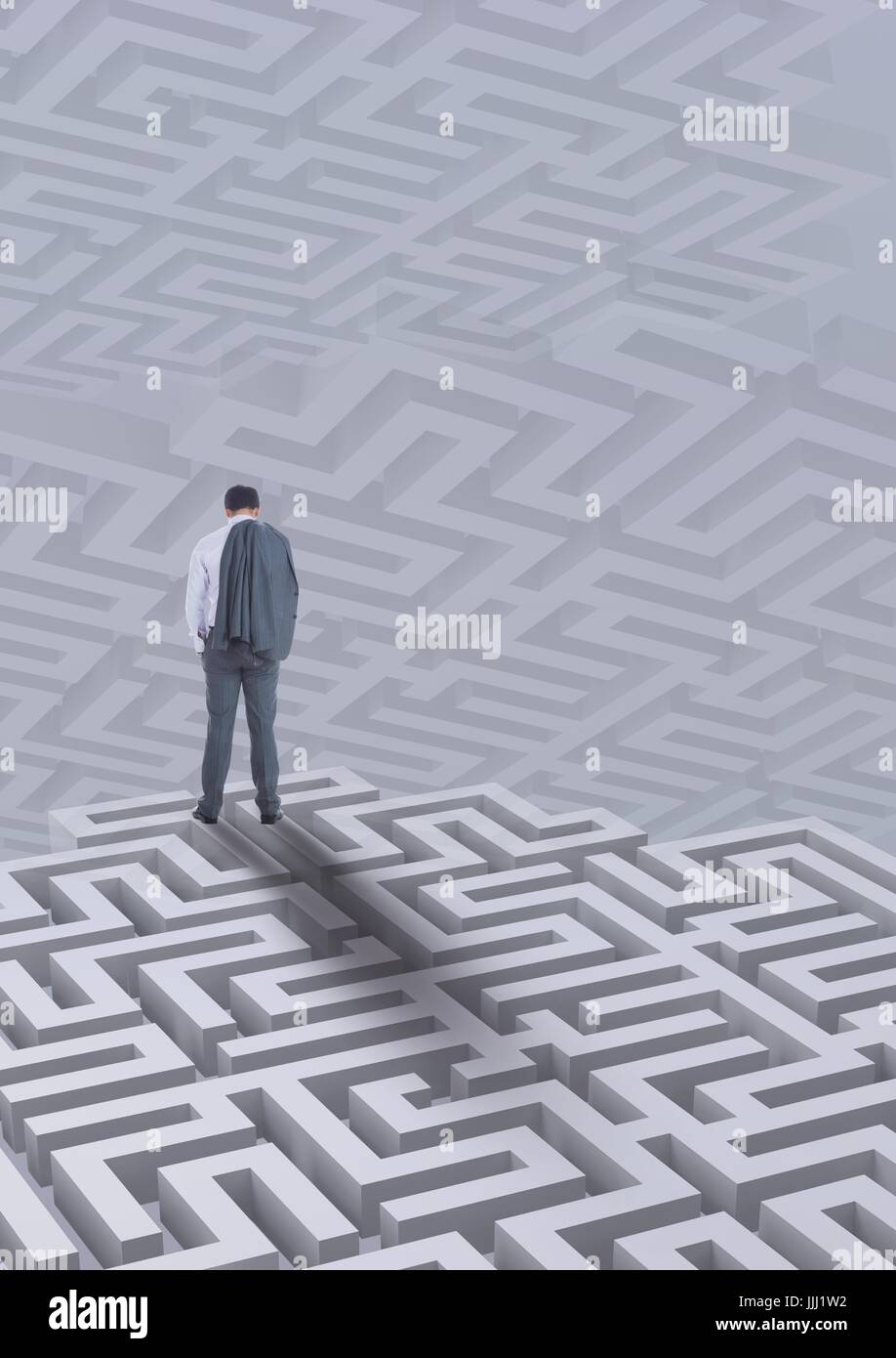 Man standing on a 3D maze against background with mazes - Stock Image