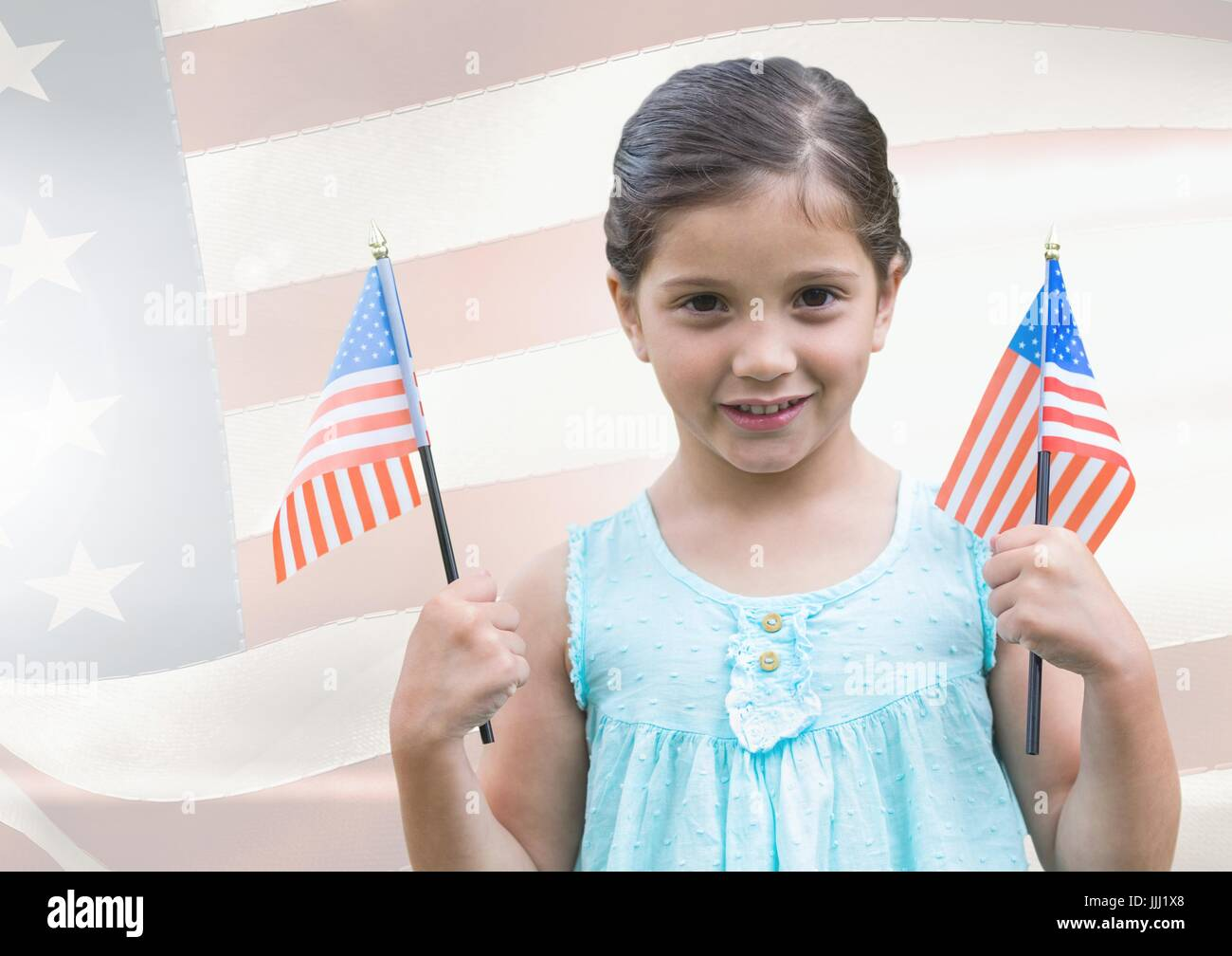 ILittle girl holding Americans flags against american flag - Stock Image