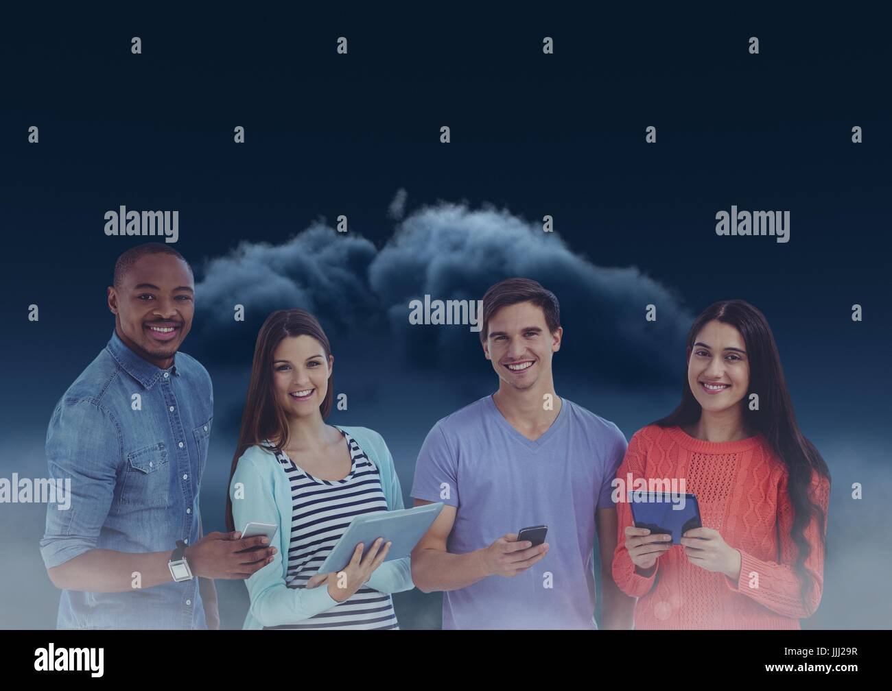 Smiling friends texting in darkness with 3D dark clouds in background - Stock Image