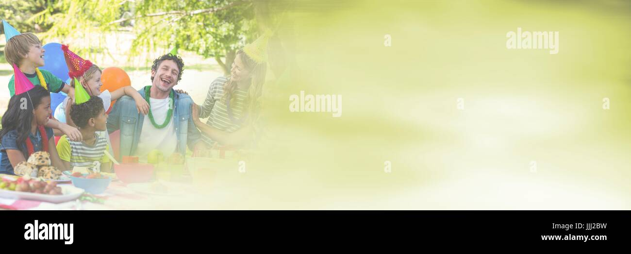adults and children having fun celebration party with green summer copy space transition - Stock Image