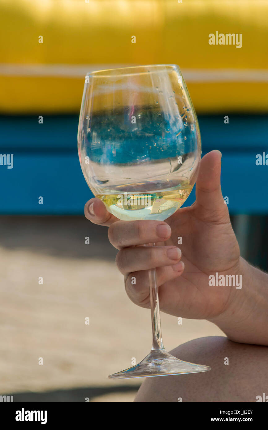 Close up of a hand holding wine glass - Stock Image