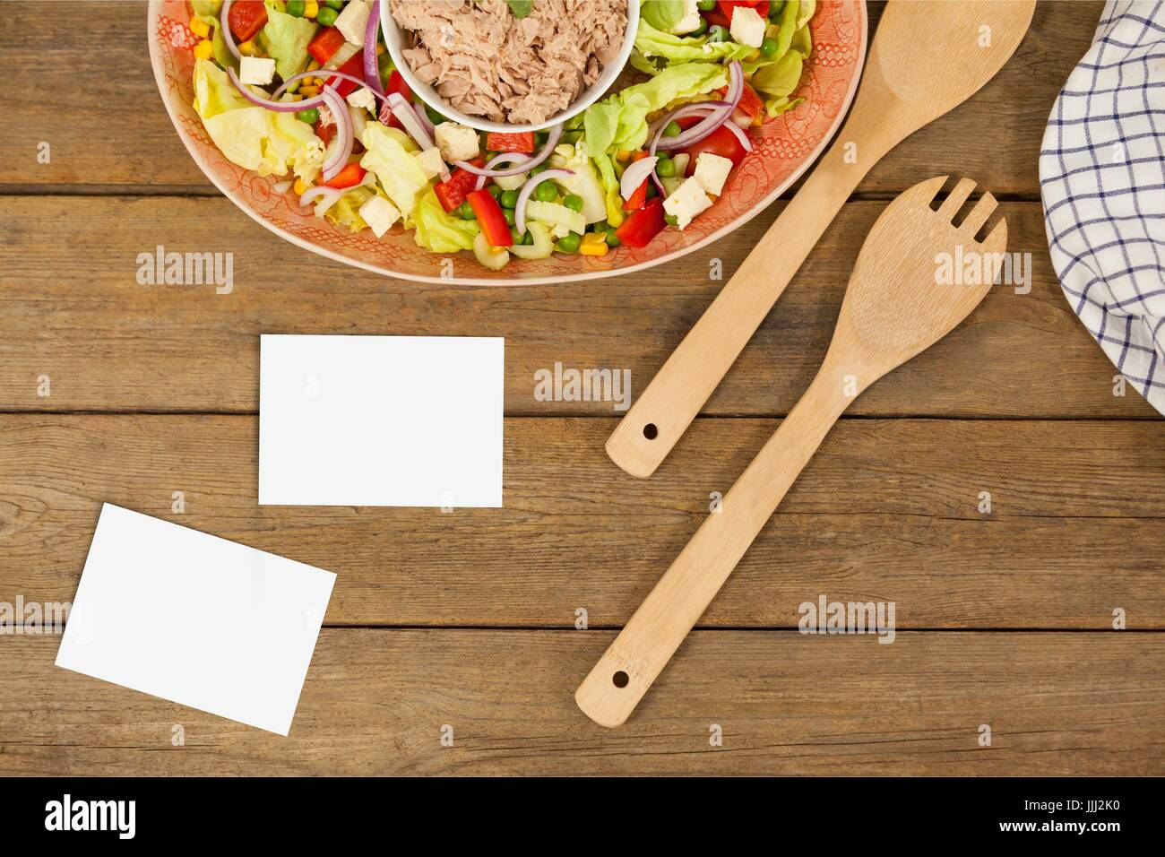 Bussiness card on wooden desk with food 3d - Stock Image
