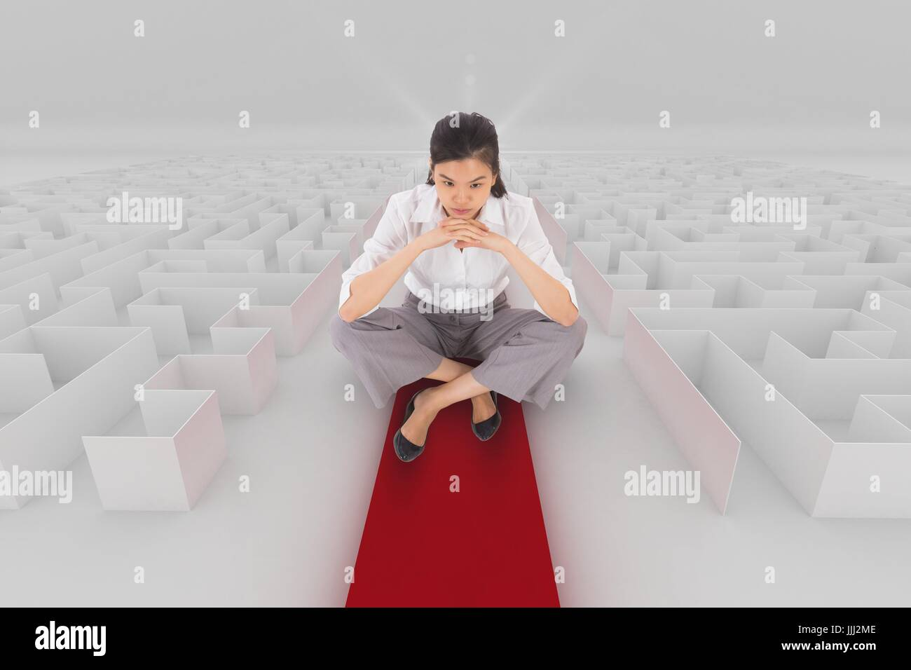 Woman sitting on a 3d maze with an arrow - Stock Image
