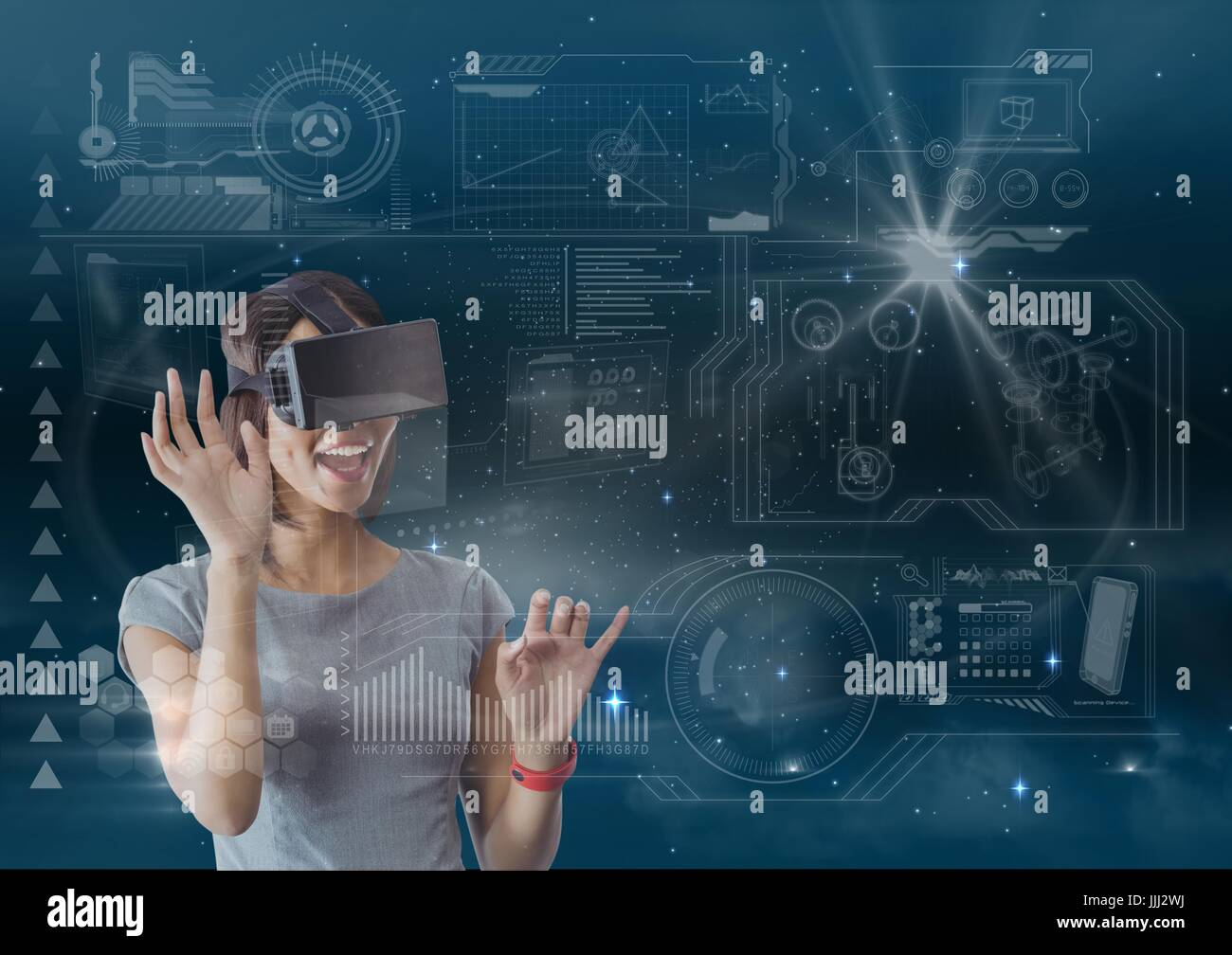 Happy woman in VR headset touching interface against blue sky with flares and stars - Stock Image