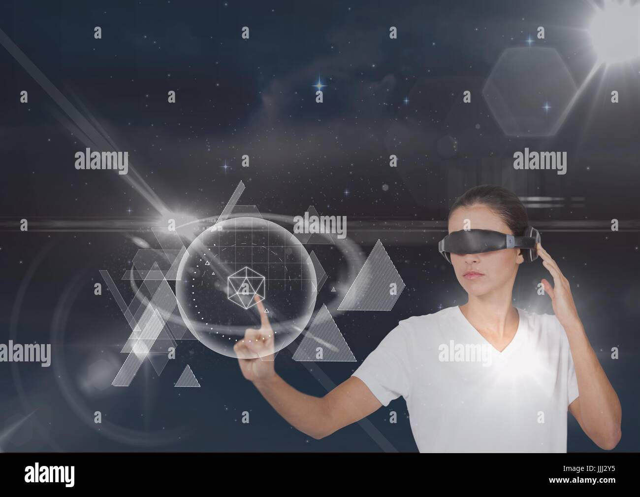 Woman in VR headset touching interface against black sky with stars and flares - Stock Image
