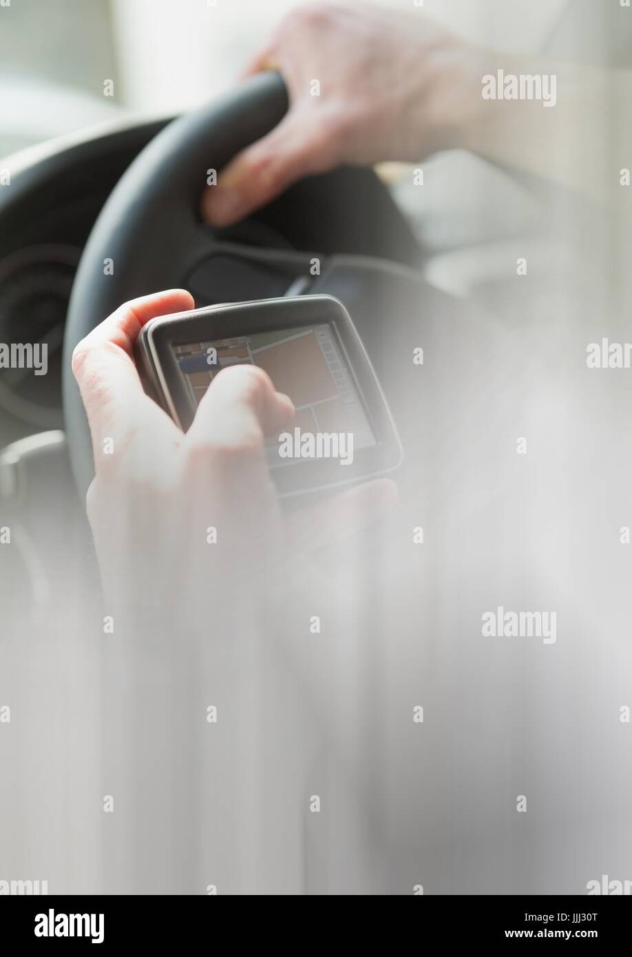 Holding GPS in car with transition effect 3d - Stock Image