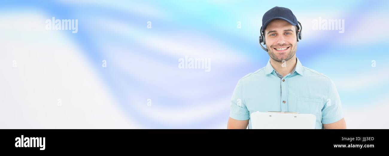 Delivery Courier with headset in front of blurred background - Stock Image
