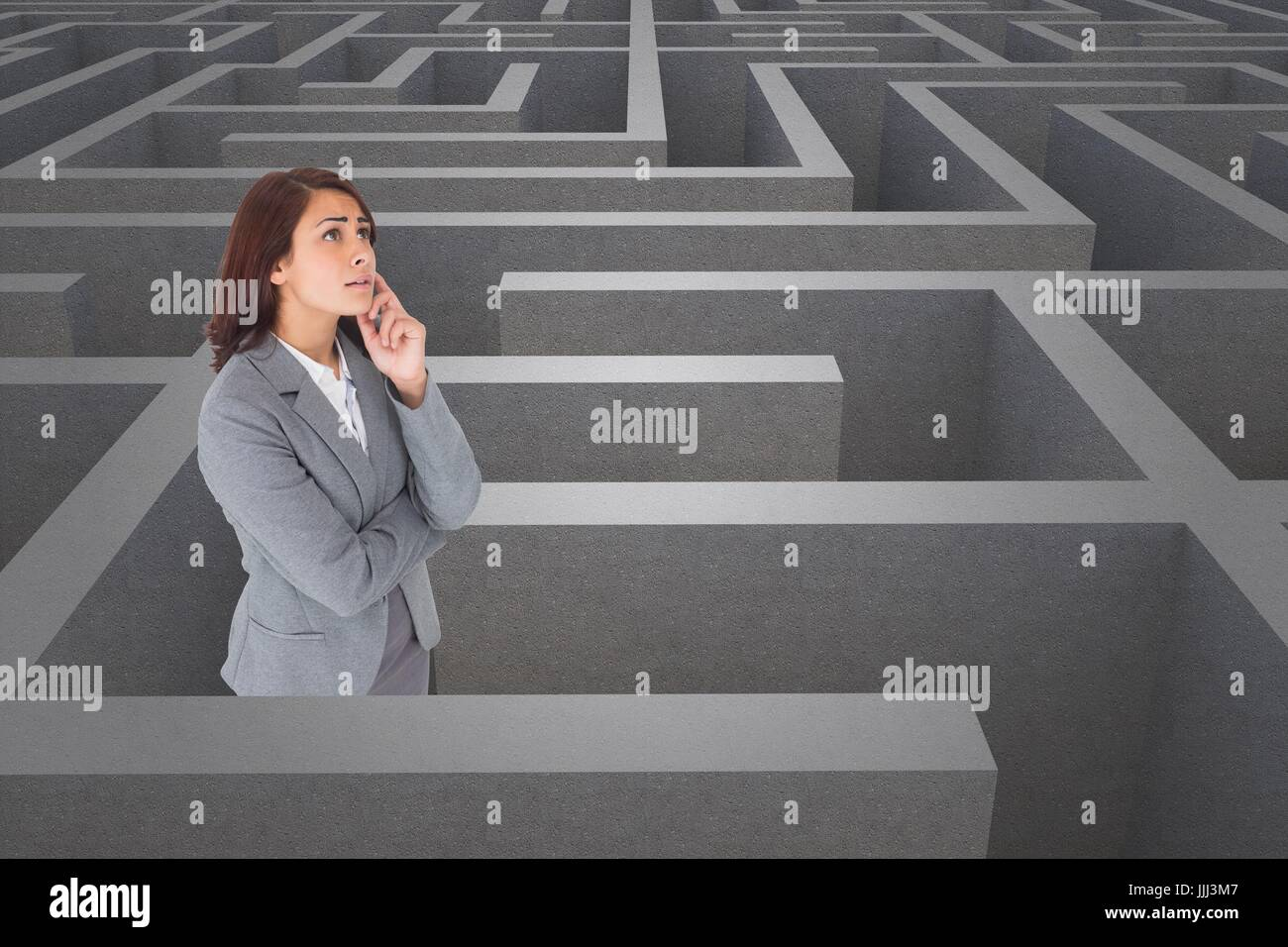 Woman thinking in a 3d maze - Stock Image