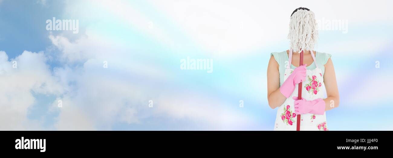 Cleaner hiding behind mop with bright background - Stock Image