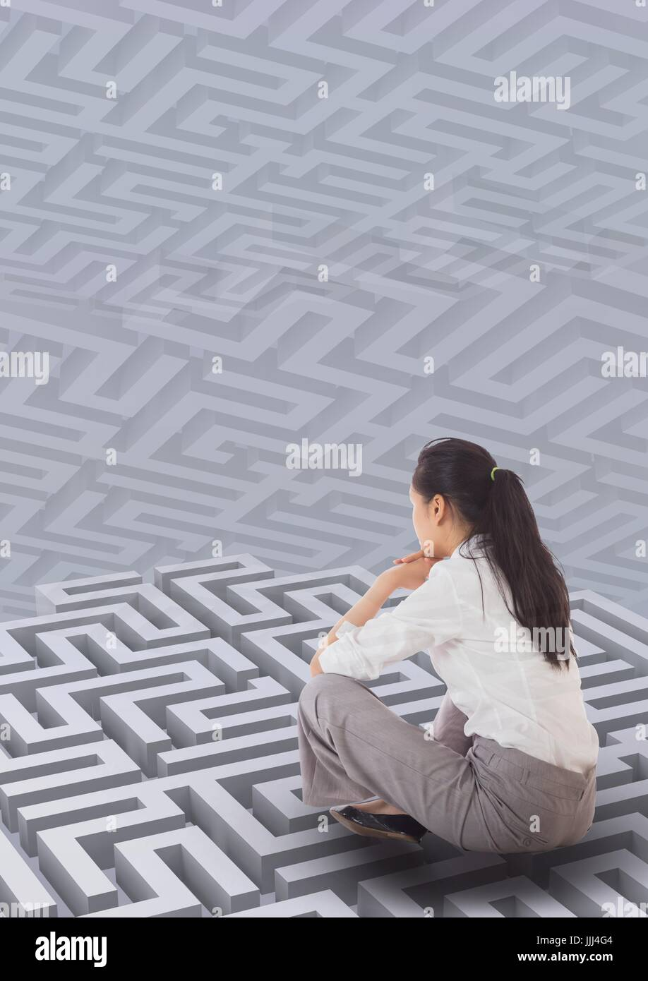 Woman sitting on a 3d maze against background with mazes - Stock Image
