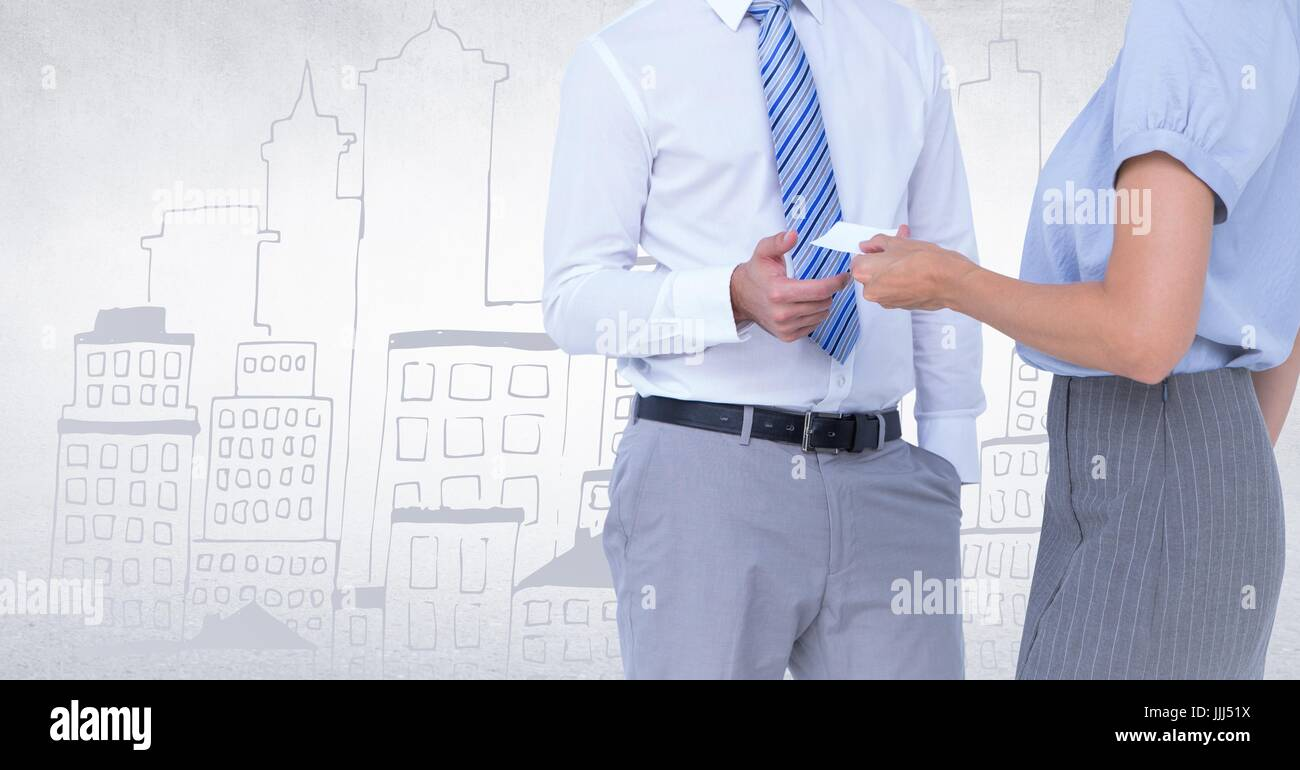 Business people mid sections swapping card against white wall with city doodle - Stock Image