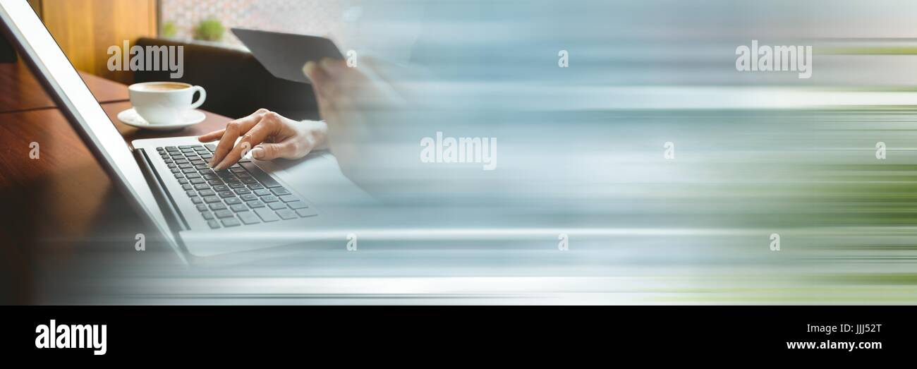 Hands online shopping in cafe with blurry blue green transition - Stock Image