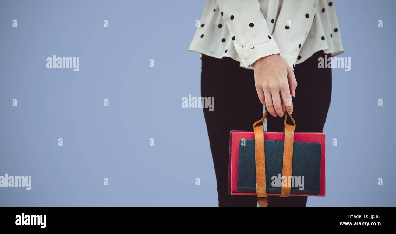 College student lower body with bag against purple background - Stock Image