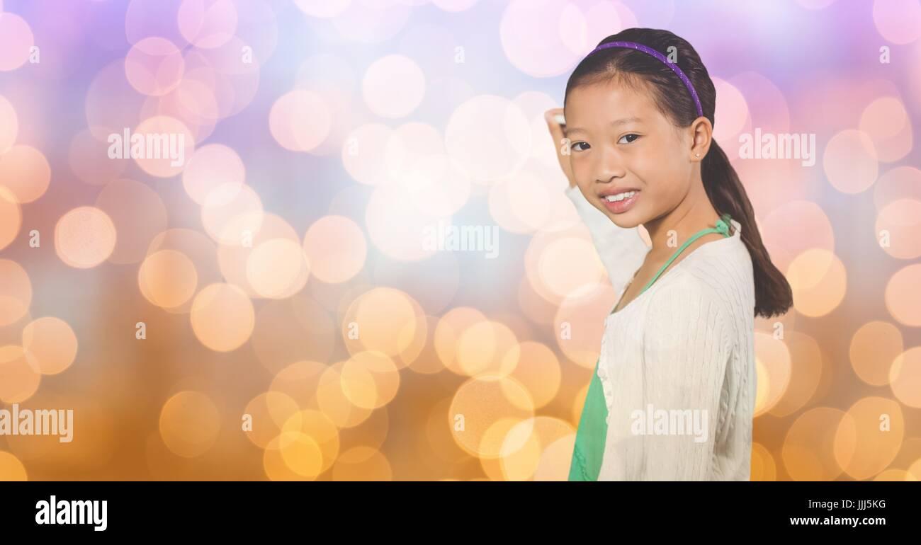 Smiling girl writing on blurred background - Stock Image