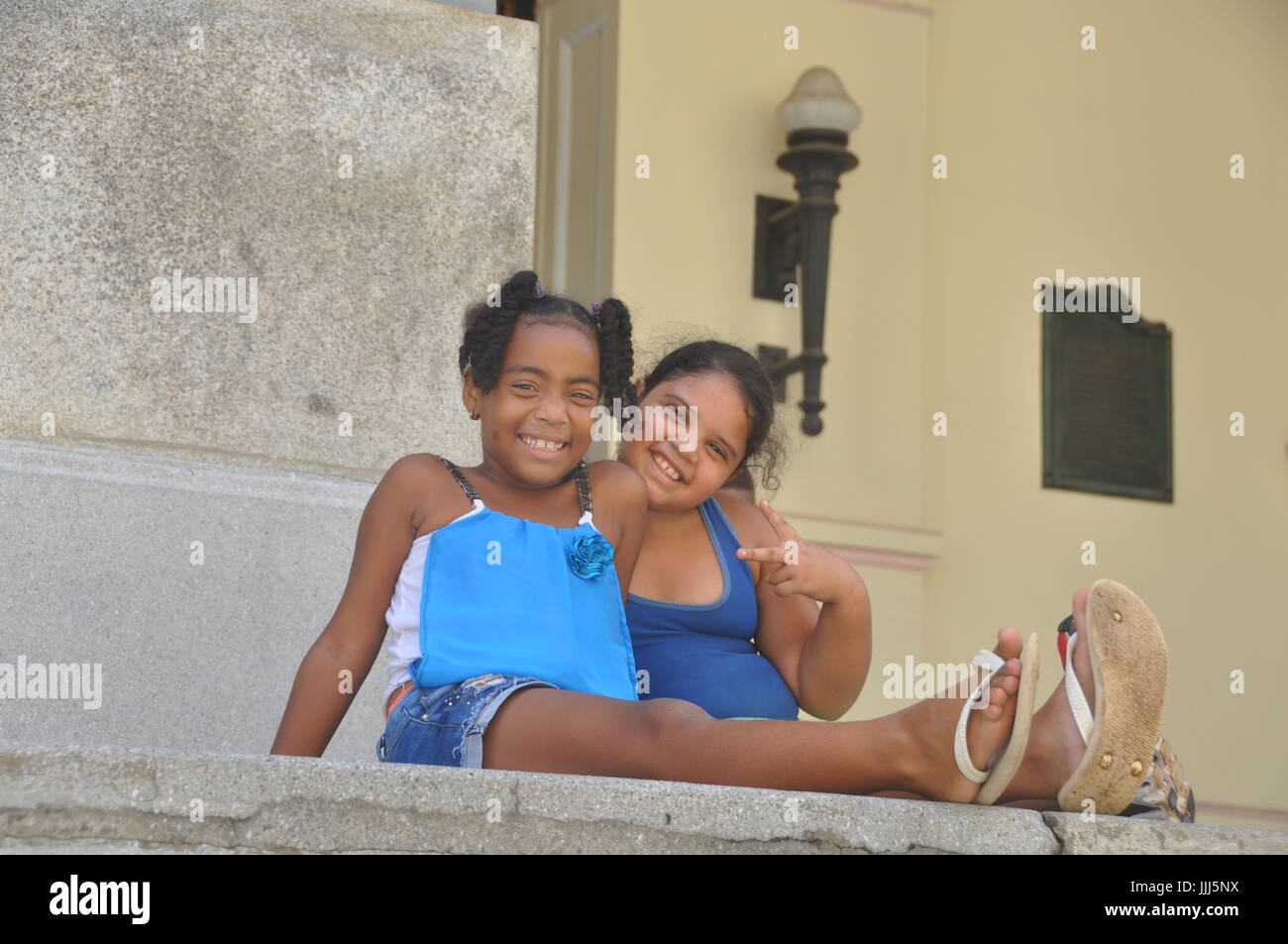 Two Young Local Cuban Girls Hang Out In Havana On A Hot Summer