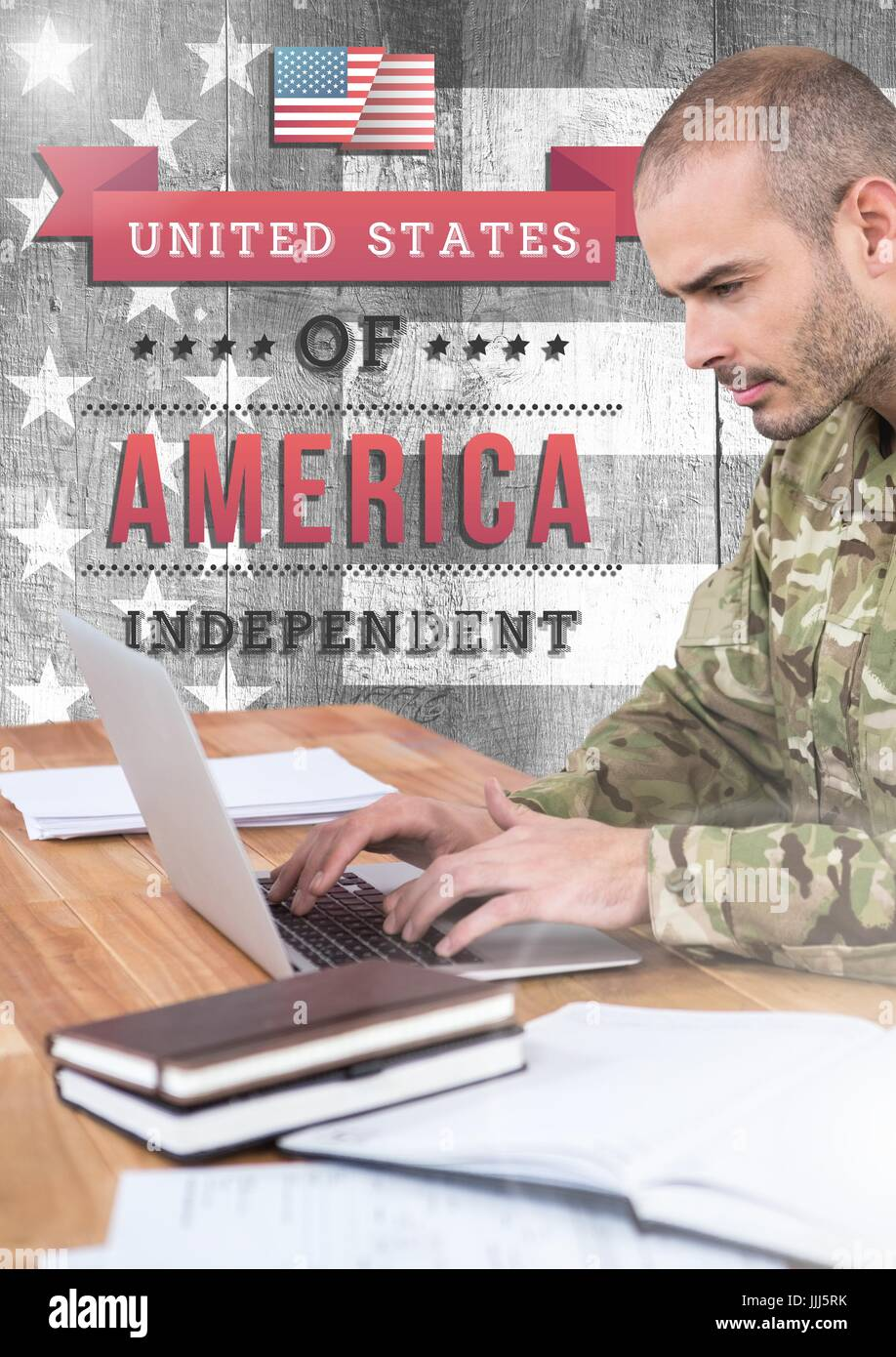 Soldier using a laptop in office with independence day scriptures - Stock Image