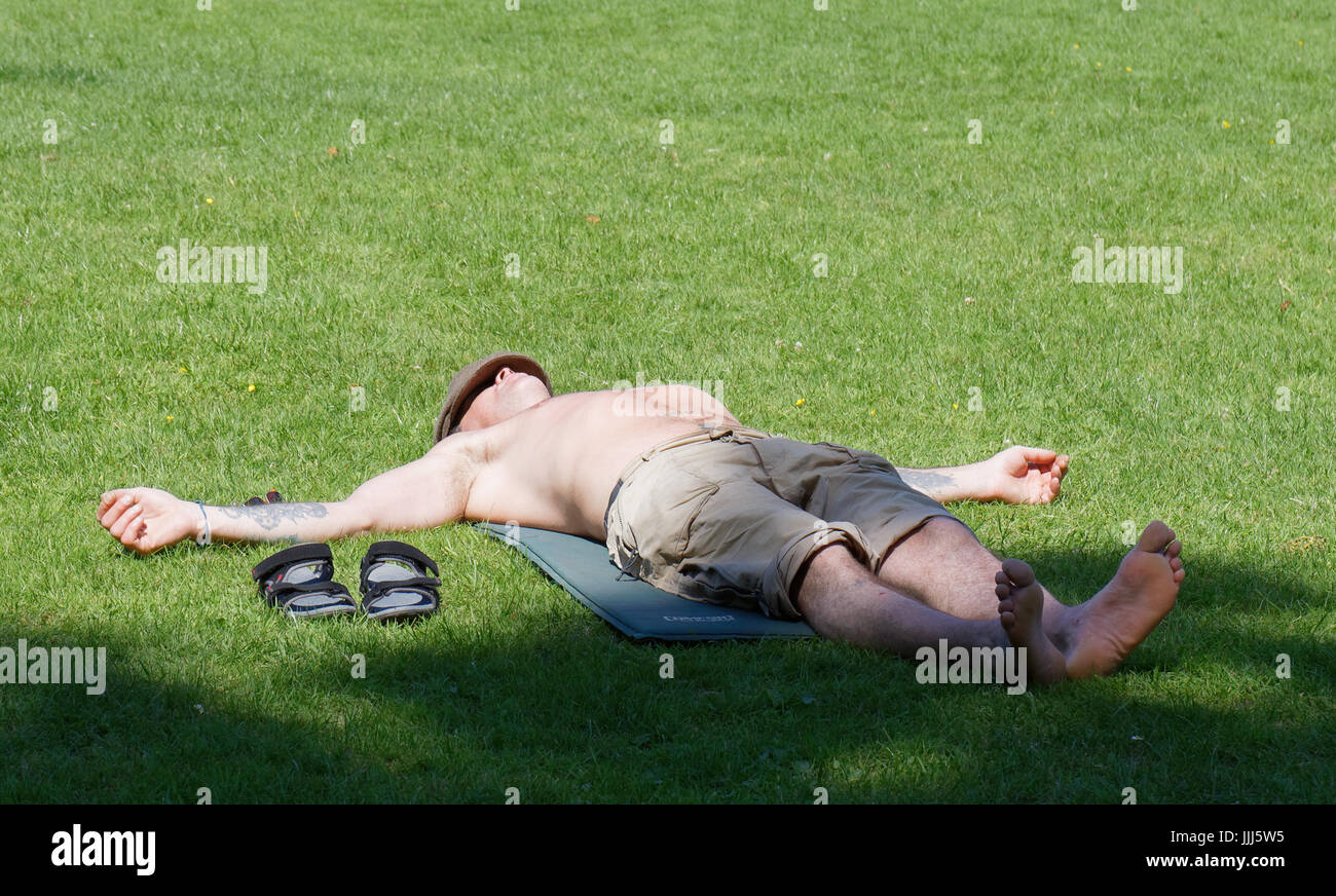 This sunbather looks like he has been crucified... Stock Photo
