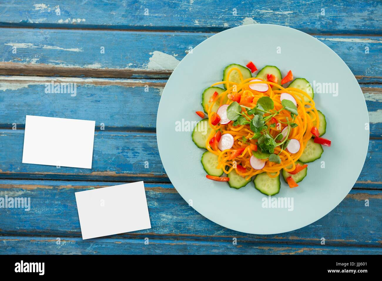 Bussiness cards on blue wooden desk with food 3d - Stock Image