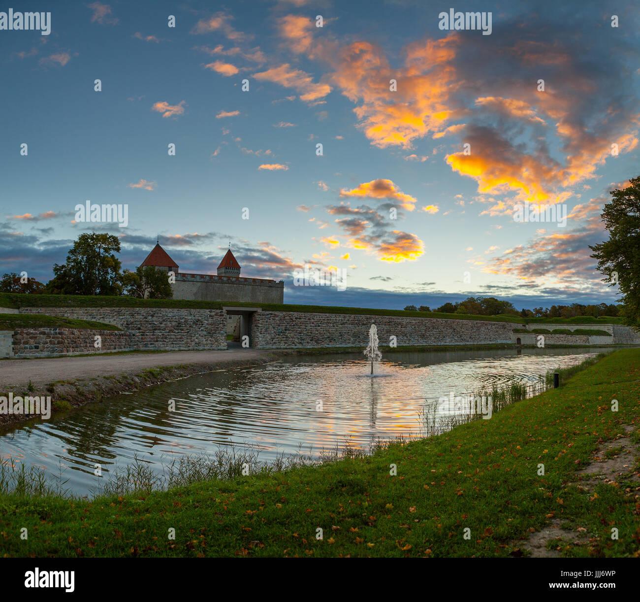 Colorful sunrise over Kuressaare castle, summer time. Saaremaa island, Estonia Stock Photo