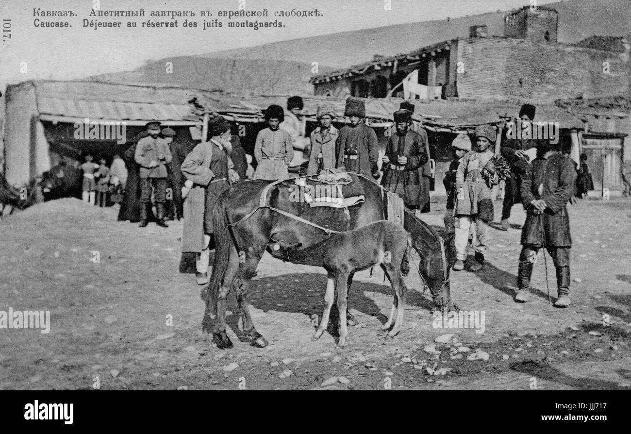 Mountain Jews of the Caucasus. Caption reads 'Caucase. Dejeuner au reservat des juifs montagnards' (lunch - Stock Image
