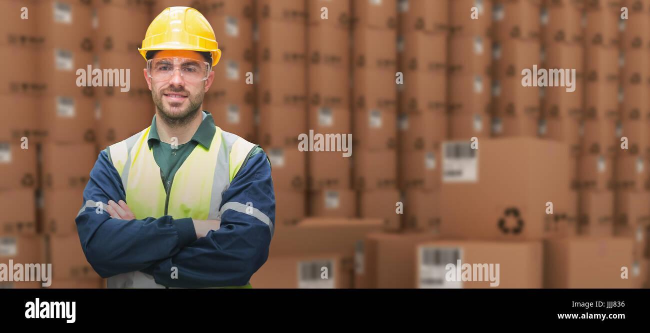 Composite image of manual worker wearing hardhat and eyewear - Stock Image