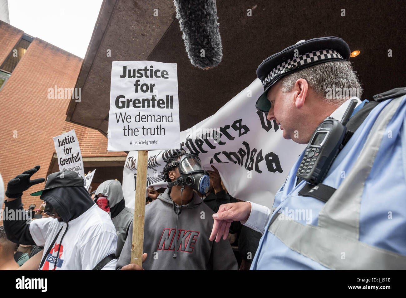 London, UK. 19th July, 2017. Grenfell Tower protest. Hundreds of angry protesters gather outside Kensington town - Stock Image