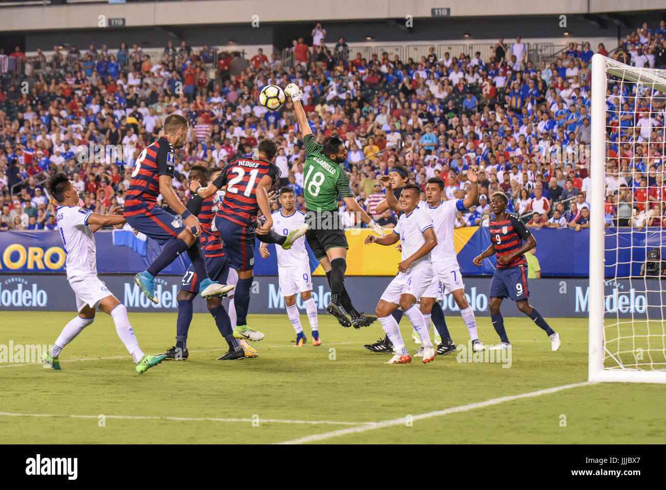 Derby Carrillo makes a save as Clint Dempsey and Matt Hedges of the USMNT United States Mens National Team attempt - Stock Image