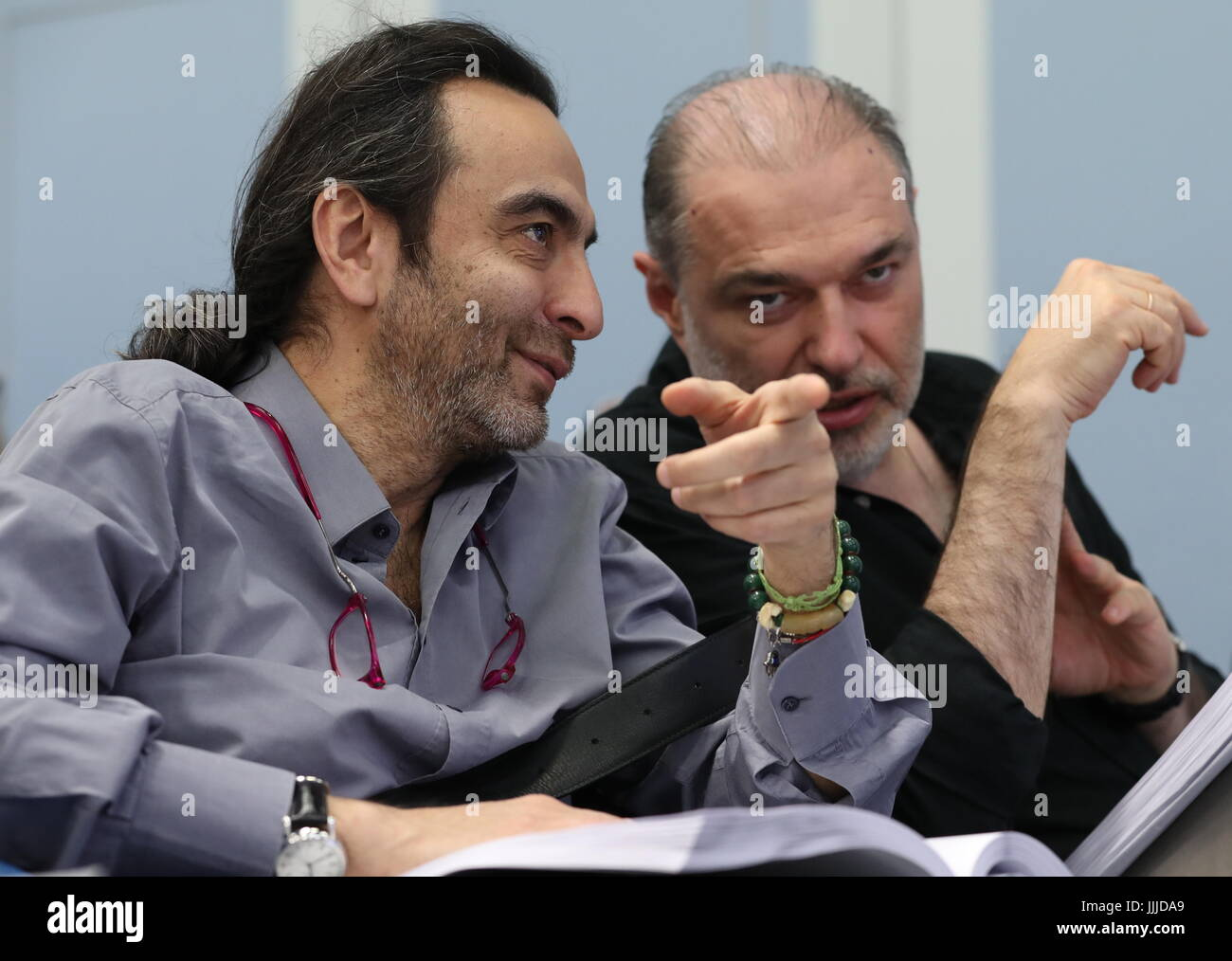 Moscow, Russia. 20th July, 2017. Film director Dzhanik Fayziev (L) and film producer Anatoly Maksimov during a presentational - Stock Image